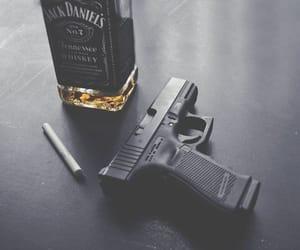 gun, cigarette, and jack daniels image