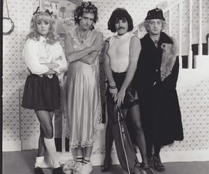 Queen, roger taylor, and brian may image