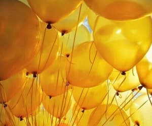 balloons, sky, and yellow image