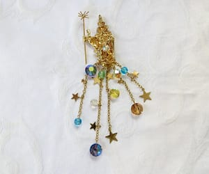 etsy, vintage brooch, and celestial wizard image
