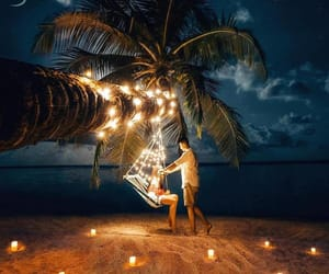 beach, candles, and ocean image