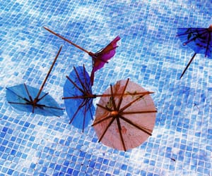 summer, swimming pool, and umbrellas image