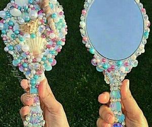 mermaid, mirror, and shell image