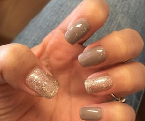 gold, neutral, and brown nails image