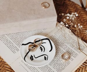 book, flowers, and jewellery image