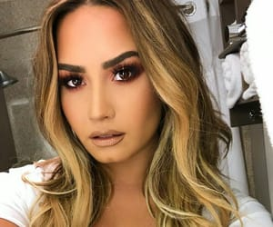 demi lovato, singer, and woman image