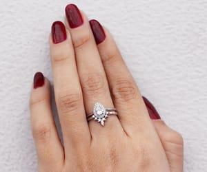 anniversary ring, bezel setting, and pear diamond set image