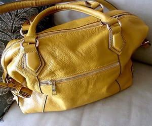 Adele, satchel, and large image