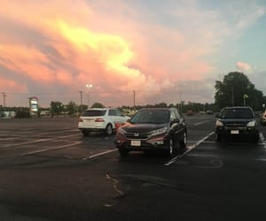 blue, clouds, and parking lot image