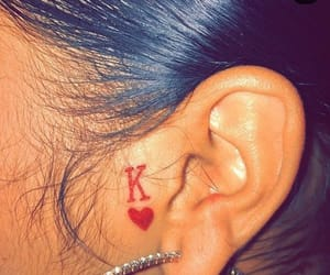 tattoo, ear tattoo, and red image