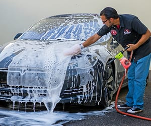 car pressure washer and hand car wash image