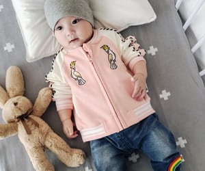 baby and baby clothes image