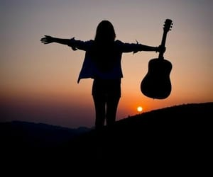 guitar and sunset image