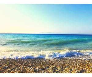 beach, blue sea, and pebbles image