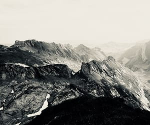 black and white, sky, and mountains image
