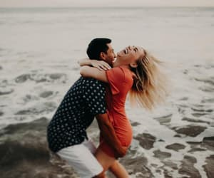 beach, couple, and goofing image