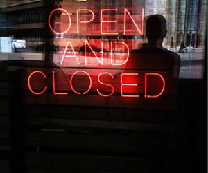 store window, open and closed, and neon red lights image