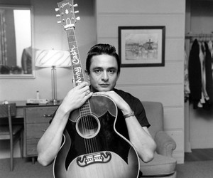 Johnny Cash, guitar, and black and white image