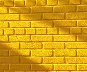 yellow, wallpaper, and brick image