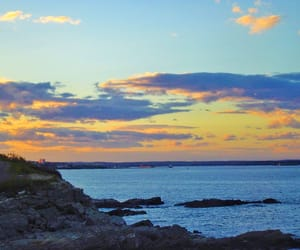 clouds, lighthouse, and Maine image
