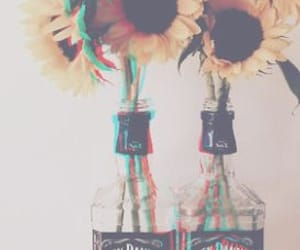 jack daniels and flower in the bottle image