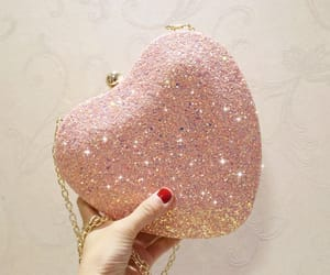 2018, heart-shaped clutch bags, and glitter clutch bags image