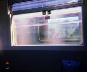 girl, train, and insideglass image