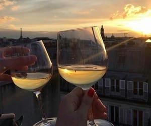 sunset, sun, and city image