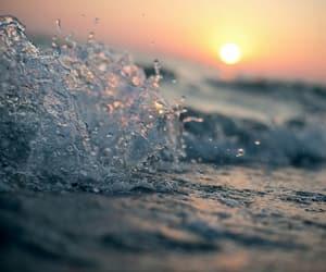 sea, sun, and water image