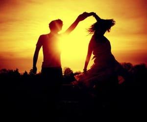lovers dance sunset image