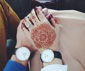 couple, henna, and watch image