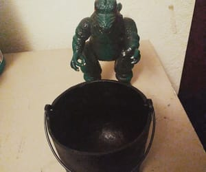 cast iron and godzilla is cooking image