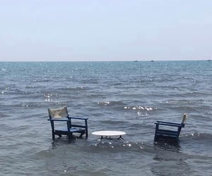 chair, sea, and table image