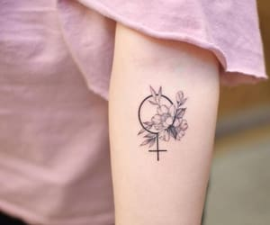 tattoo, flowers, and feminism image