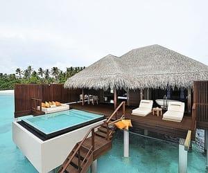 Island, resort, and overwater villa image