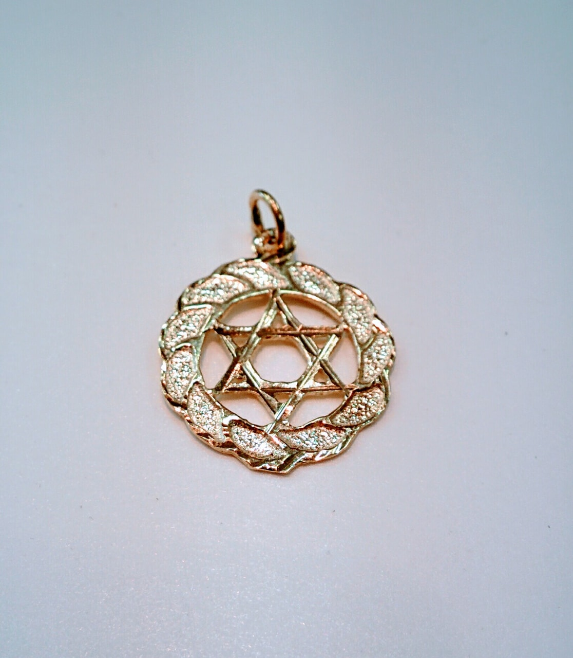 article, star of David, and gold pendant image