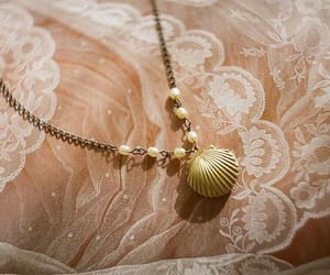 shell, necklace, and lace image