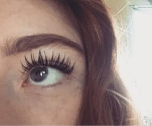 curly hair, ginger hair, and long eyelashes image