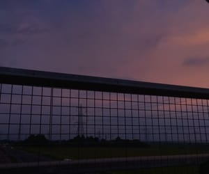 cars, clouds, and fence image