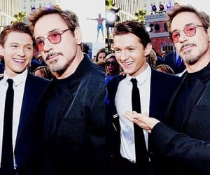robert downey jr, tom holland, and friends image