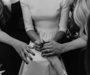 bride, groom, and bridesmaids image