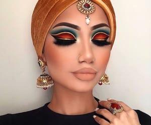 earings, lips, and eyeshadow image