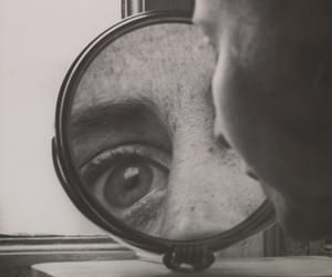 black and white, eye, and mirror image