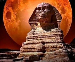 sphinx, blood moon, and ancient statues image