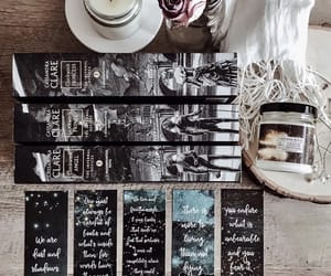 bookmarks, books, and candle image