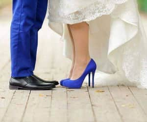 bride, groom, and heels image
