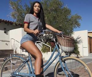 bike, model, and long tan legs image