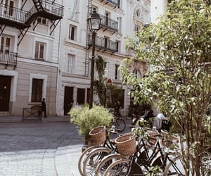 apartment, bikes, and buildings image