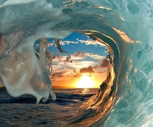 waves, sea, and sun image