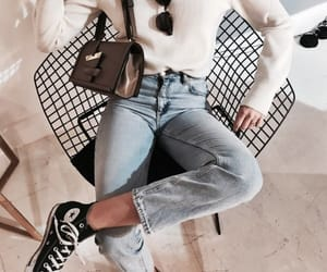 blue jeans, sneakers, and sunglasses image